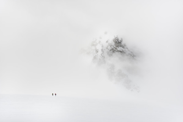 Paul Cornforth and Matt Reedy questing into the fog north of Tafeltinden, Lyngen Alps, Norway