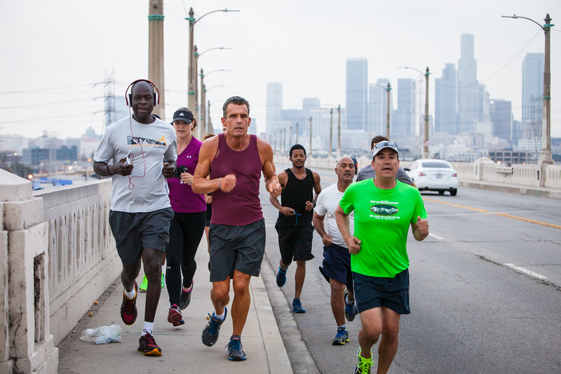 FAVORITE ****  L.A. Superior Court Judge Craig Mitchell leads his Skid Row Running club over the 6th St. Viaduct.