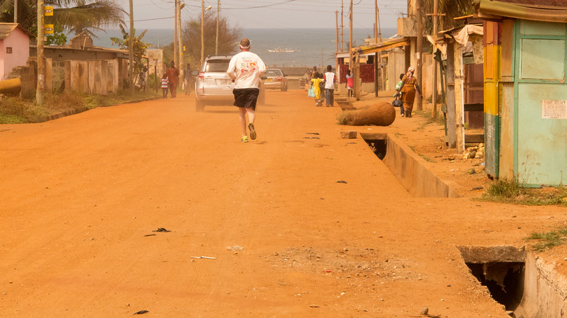 Skid Row Running Club member Ben Shirley at  mile 18 of the Accra International Marathon in Ghana.