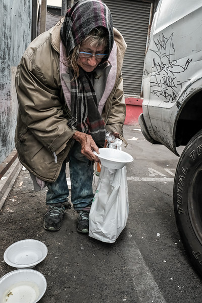 Leanne feeding street cats on Stanford Avenue in December 2016