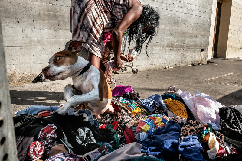 Woman sorts through donated clothing on San JUlian Street
