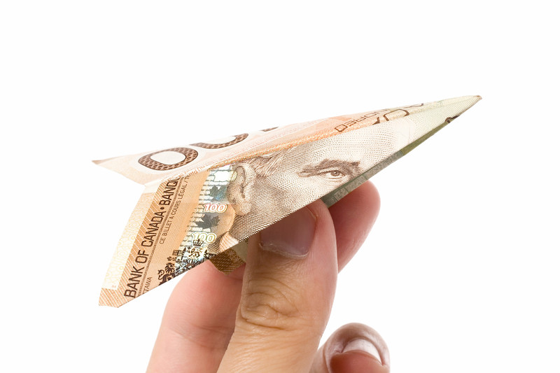 canadian dollar paper airplane