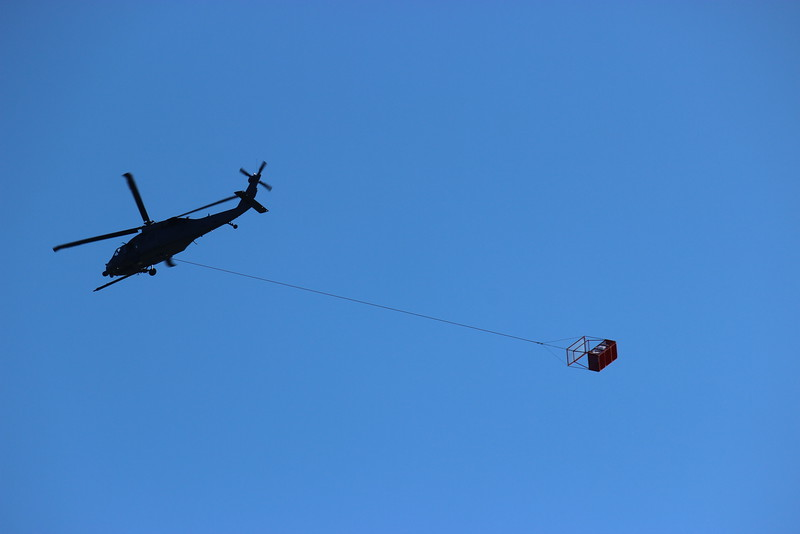 Helicopter Towing a Basket over San Francisco Bay