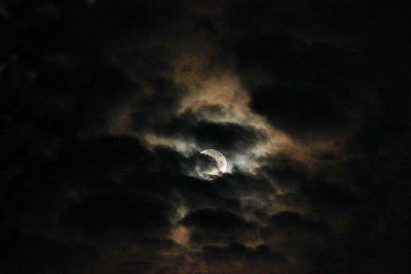 Blood Moon Behind Dark Clouds
