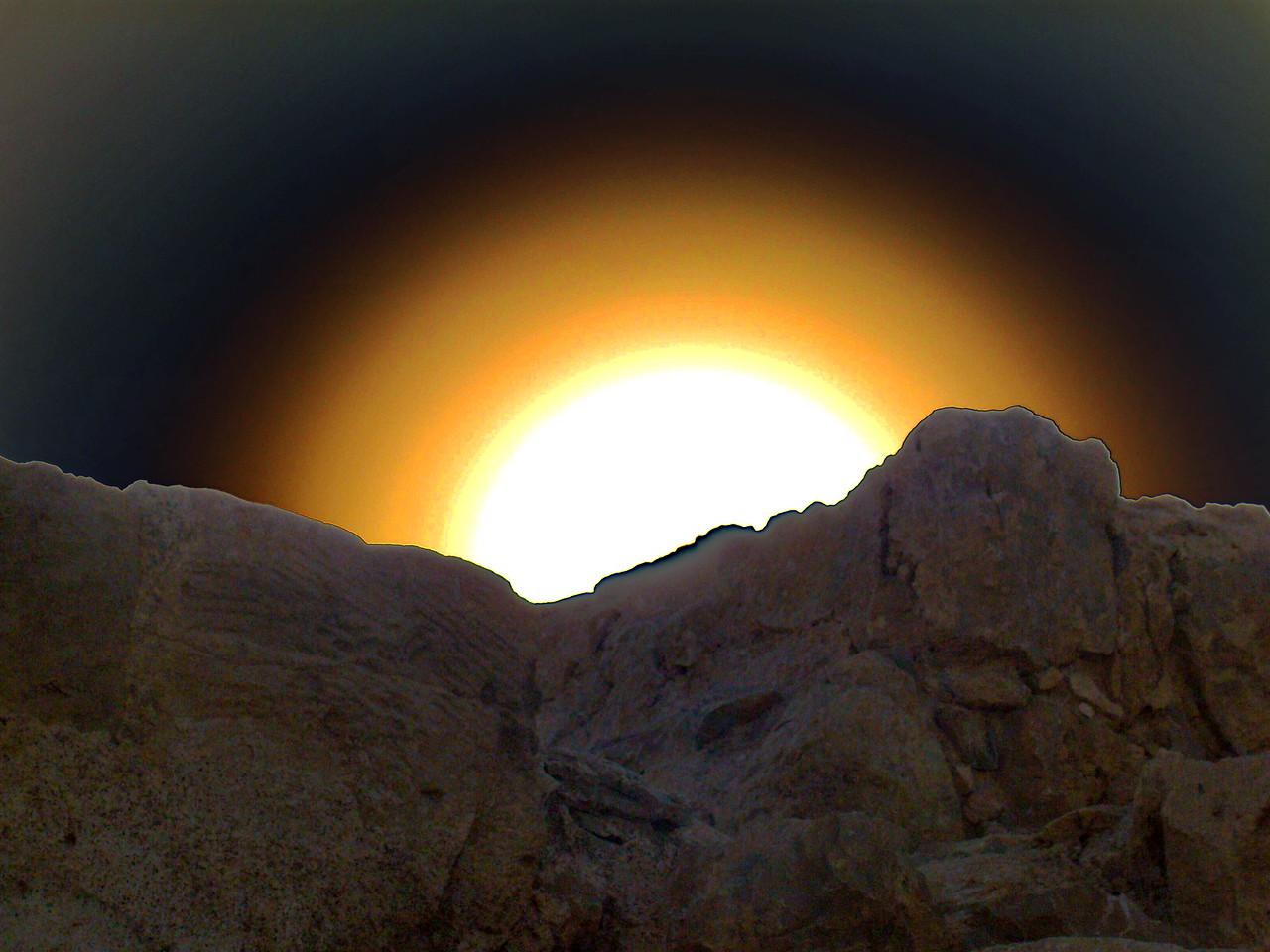 Sun behind the Judean Mountains