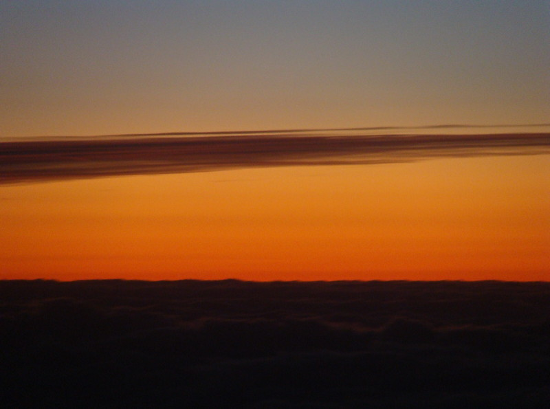 Red Sunrise above the Clouds