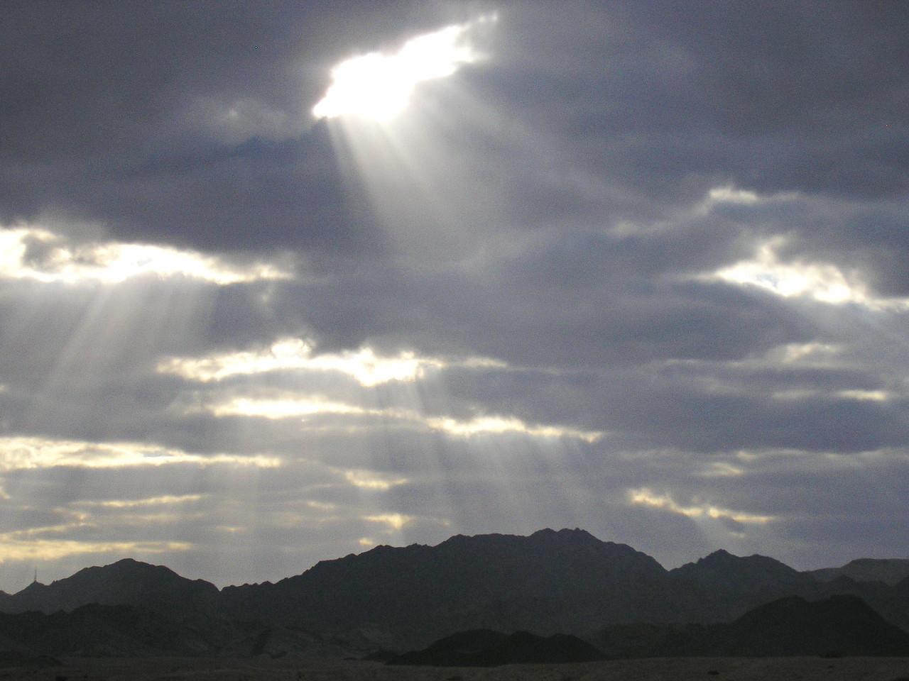 Sun Rays Stream through the Clouds