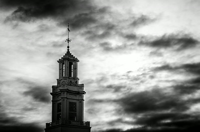 Andover Baptist Church spire with storm clouds, mono