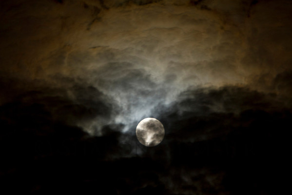 Moon Passing Through Clouds  ©  2011  Sharon Nummer  A shot taken very quickly as the moon and clouds moved in the sky.    Taken about 12:30am.  I love how the moon illuminated the surrounding clouds.  A very nice effect.