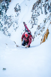 Paul Sherman climbs a steep couloir in the Wasatch Mountains, UT