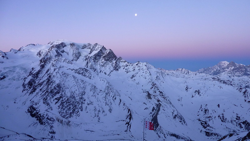 Morning moon on the Mont Vélan and Mont Blanc and Gr. Jorasses on the right. Taken from Cabane Valsorey 3030m.