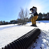 KRISTOPHER RADDER — BRATTLEBORO REFORMER<br /> Django Grace, a student at Hilltop Montessori School, slides on a tube while skiing at Living Memorial Park on Thursday, Jan. 30, 2020.