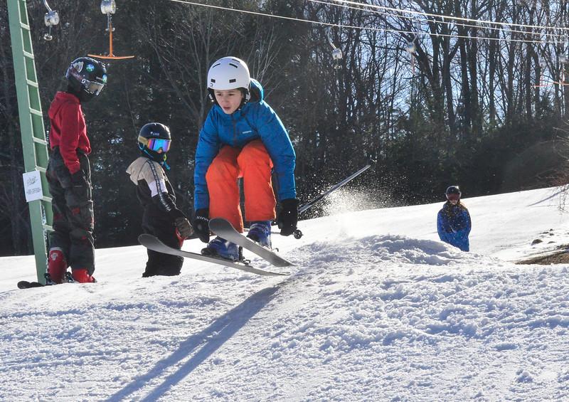 KRISTOPHER RADDER — BRATTLEBORO REFORMER<br /> Eddie Oakley, a seventh-grader at Hilltop Montessori School, in Brattleboro, goes flying off a jump while skiing at Living Memorial Park on Thursday, Jan. 30, 2020.