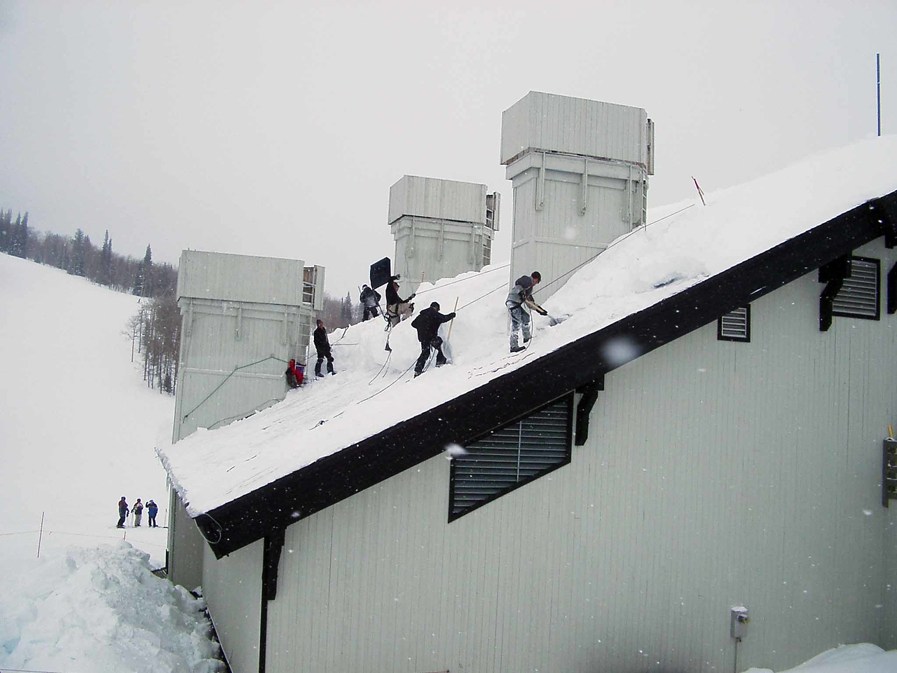 311 Clearing Snow from Rendevous Lodge Roof