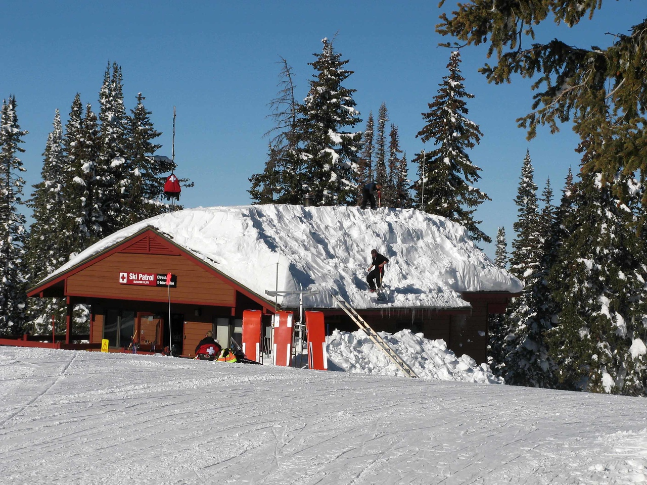 194 Ski Patrol clearing snow from their hut