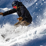 Female Snowboarder in Powder