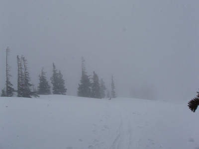 At the top of the slope we are about to ski. Big snowflakes coming down with blowing wind, visibility was pretty low at this point.