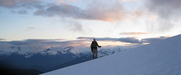 Phil with the Tantalus Range behind him.  The sunset is nice. But it is starting to get cold...and the snow icy.