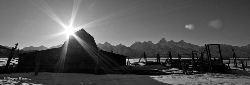 Moulton barn sunshot with the Teton range in the background.