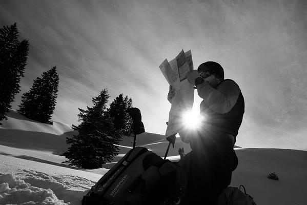 Tobias Kaufmann checks his map before heading up toward Häderenberg, Swiss alps