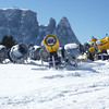 Snow cannons in front of a Dolomite.