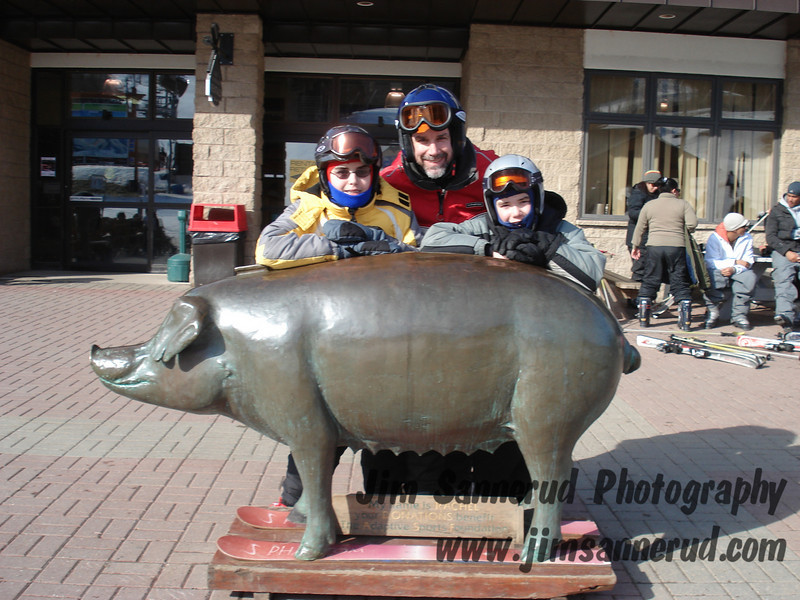 Pig on skis. Me and my kids. I don't understand the significance of the pig, but it made a cute photo op for a family photo.