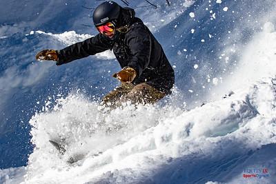 Female Snowboarder in Powder