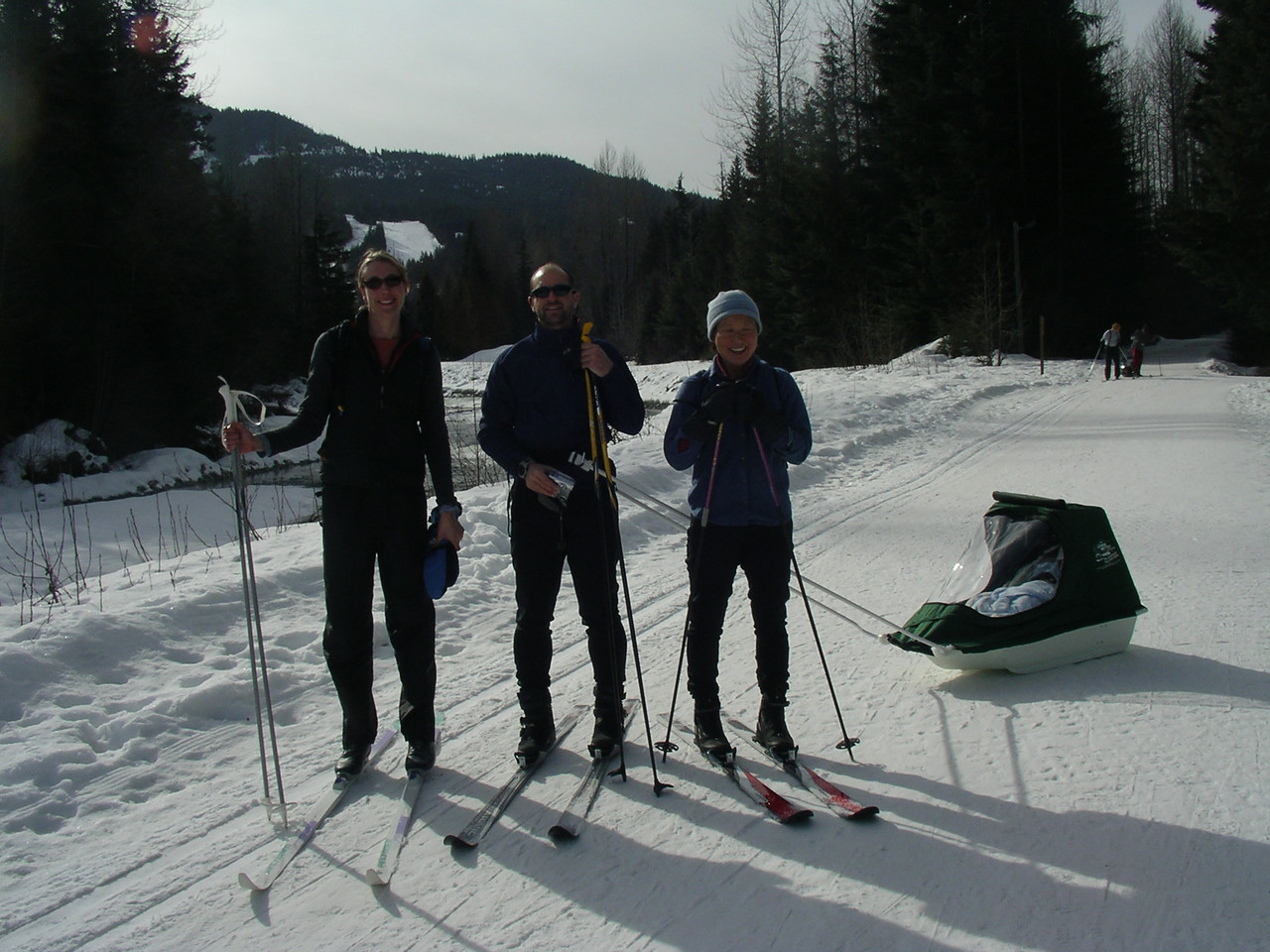 Gretchen (who was also vacationing in Whistler for the weekend) Jeff, Kim, and Corri in her little ski carriage.