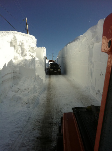 3/28/2011 - Our road further up the hill after the town's massive snow thrower made its pass and opened a single lane.