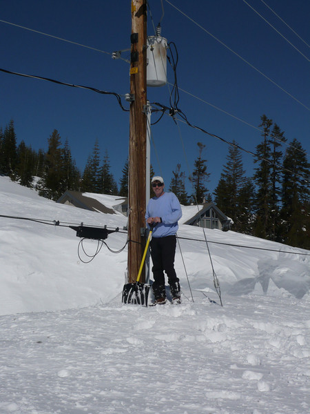 3/28/2011 - Standing next to the power pole in front of our house. The phone cable is level with my waist, power lines are overhead.