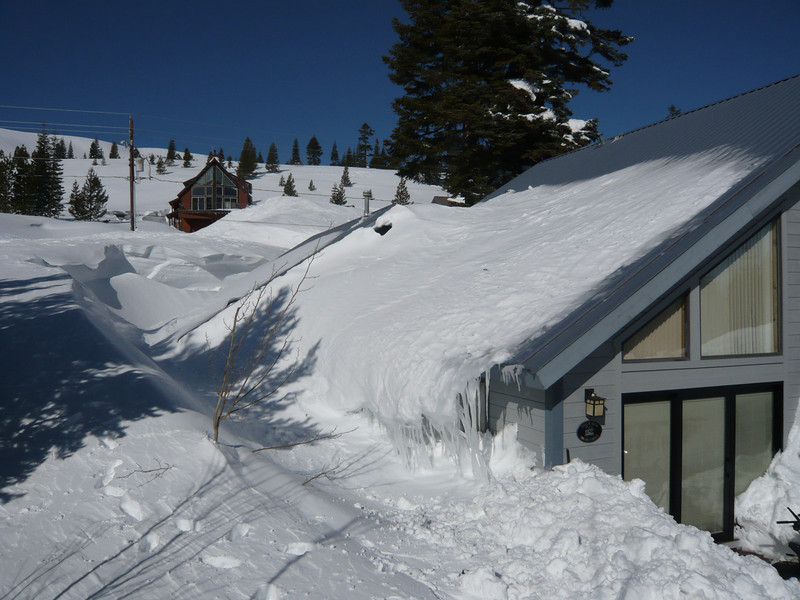 3/28/2011 - Rear and South Side of House. The Dining Room and Kitchen windows are on that side and underneath the overhang of snow and ice from the roof.