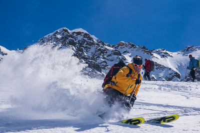 Rich Meyer enjoys some fine powder on the Sulden Glacier. Ortler Ski Tour, Sud Tirol, Italy.