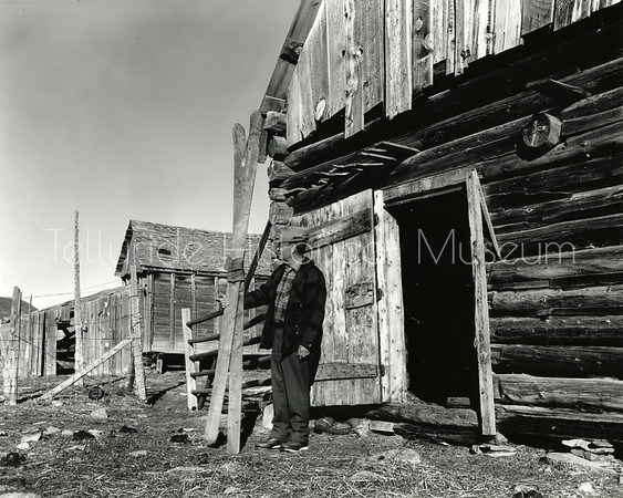 2005-01-111: Homer Reid With Old Skis Found In Barn - Last Dollar Road - Telluride, CO. May, 1964