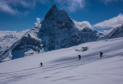 Skiers on the Stockli Glacier. The North Face of the Matterhorn in the background. Haute Route Ski Tour, Switzerland.
