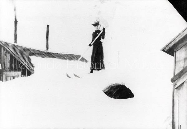 2004-01-257: Beth Batcheller Skiing On Roof  Of Her House At Tomboy Mine 1906-1908