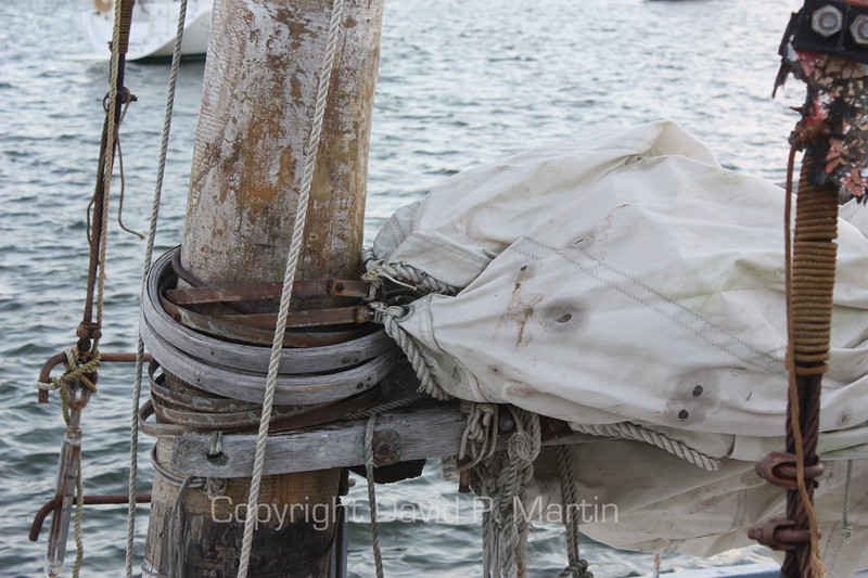 Mast loops - Because winds can come up so quickly on the Chesapeake, the sails are attached to the mast with wooden or metal loops so that loosening a rope can drop the sail quickly. (2009)