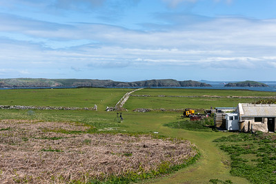 The farm and the old stone fences on central Skokholm. Skomer in the background.
