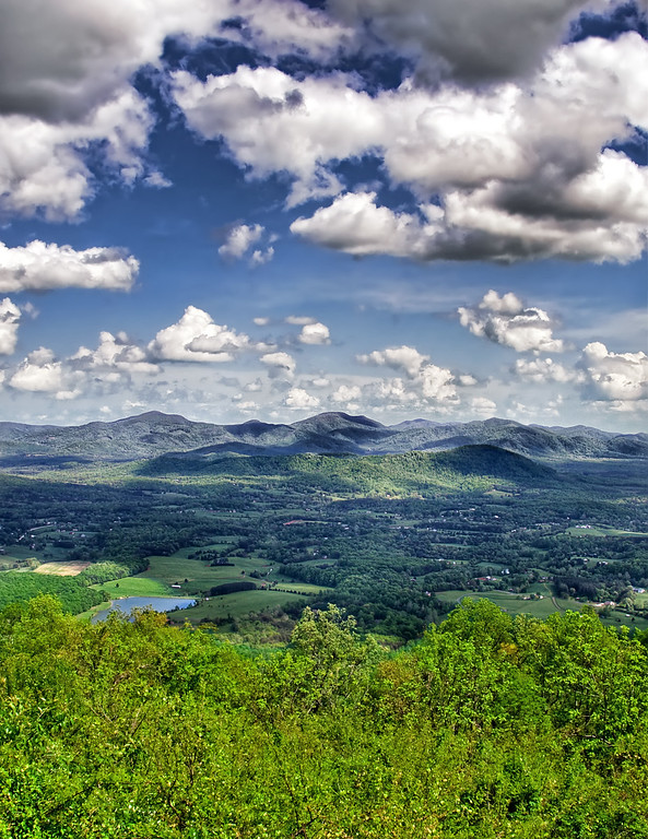 Blue Ridge Skyline<br /> The view from the Blue Ridge mountains on a crisp spring day.The darker green trees of the valley contrast with the younger lighter green leaves of the mountain top trees in the foreground. HDR