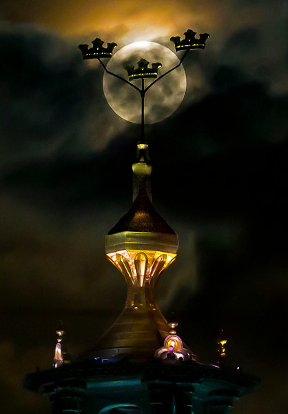 Full moon behind the tower of city hall in Stockholm