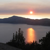 July 13, 2012.  Sunset, with smoke in the sky, over Crater Lake National Park, Oregon.