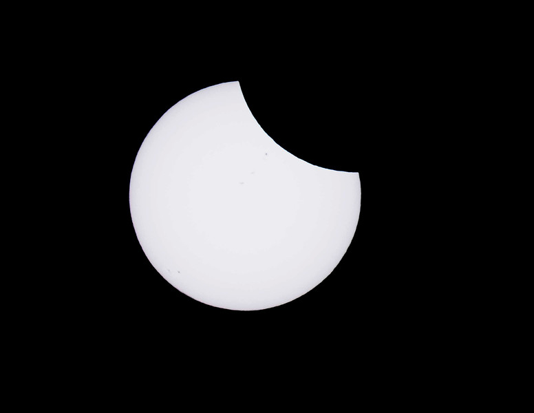 Partial Eclipse with Sunspots
