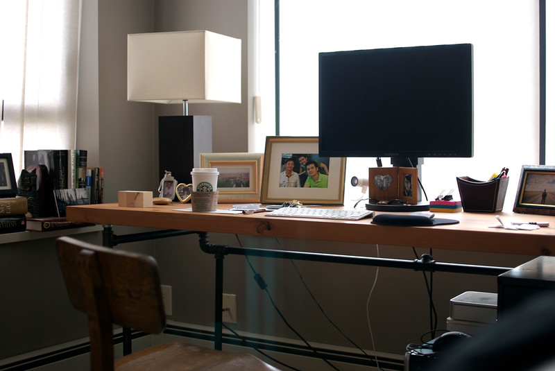 my desk made from plumbing pipes and reclaimed fir.