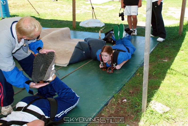 Larry teaches Raina the proper freefall body position.