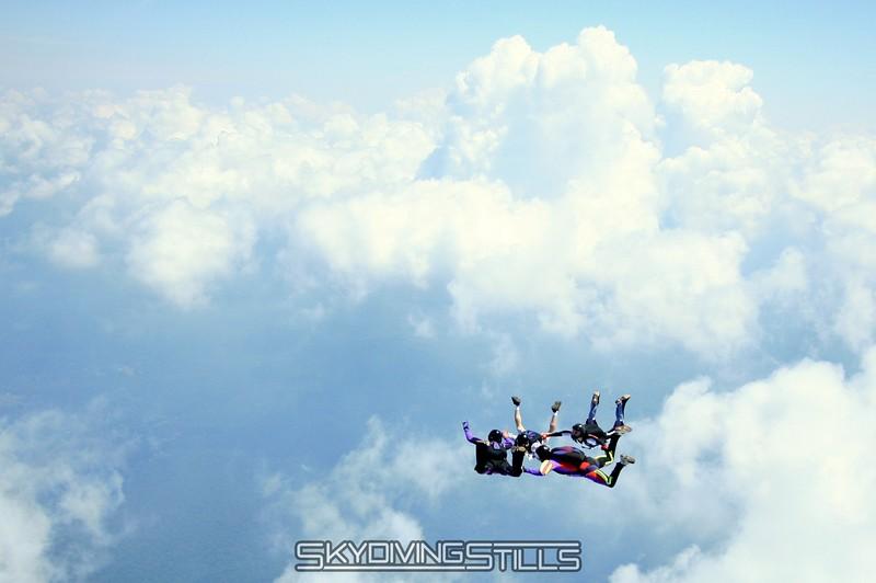 4-way flies beside towering clouds. 6/28/08