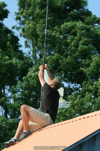 Don climbs on the roof to fix the wind meter. 7/12/08