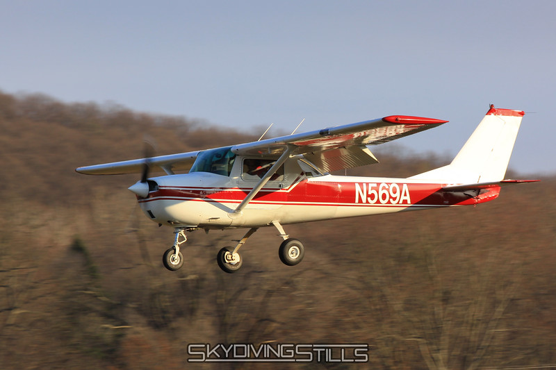Cessna 152 on final. N569A. 11/21/09