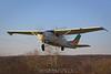 Cessna 206 climbs away. 11/29/09