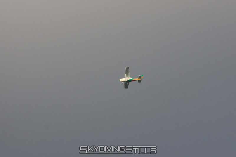 Cessna 206 descends below the gray clouds. 6/13/09