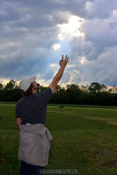 Doug summons the power of the sun to finish lighting the bonfire. 5/8/10