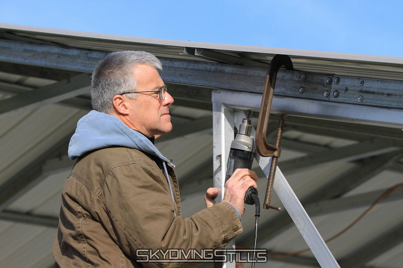 Don installs the reinforcements he designed for the metal tent. 12/10/11